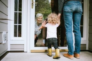 Little Girl Visits Grandparents Through Window